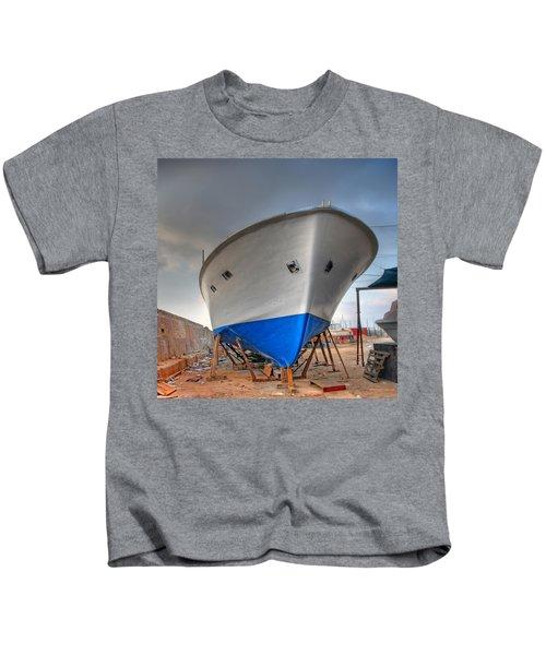 a resting boat in Jaffa port Kids T-Shirt