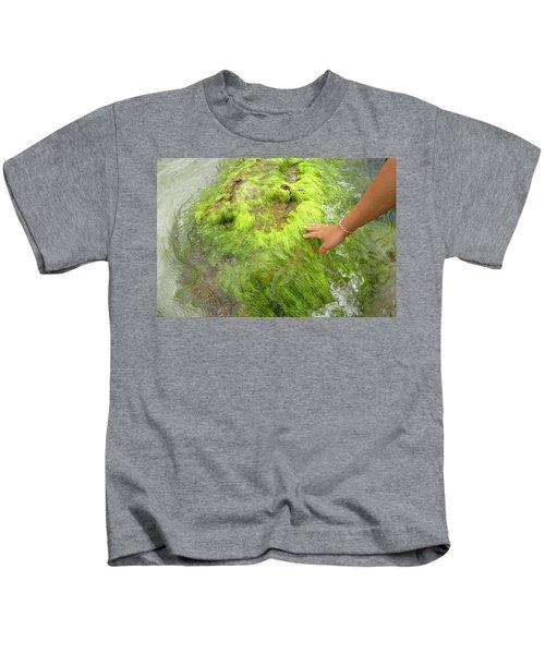 Han Of A Young Woman Touching A Rock Kids T-Shirt