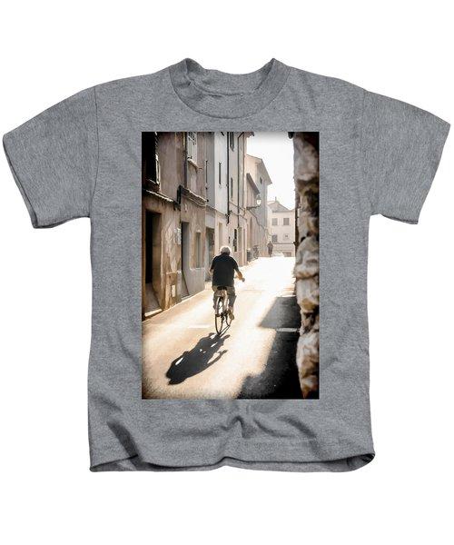 Man Riding Bicycle In Street In Puerto Pollenca Kids T-Shirt