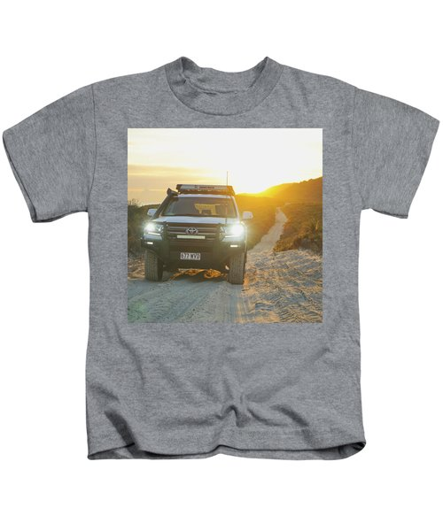 4wd Car Explores Sand Track In Early Morning Light Kids T-Shirt