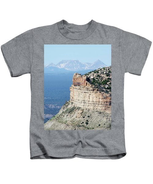 A Fire Scorched Mesa Verde With Alpine Peaks Behind Kids T-Shirt