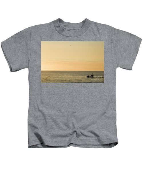 A Small Fishing Boat In Sunset Over Cardigan Bay Aberystwyth Ceredigion West Wales Kids T-Shirt