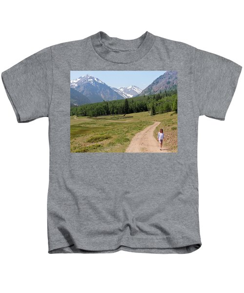 A Woman Walks A Road On The Alpine Loop Backcountry Byway Kids T-Shirt