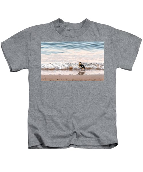 Baby Duck Running On A Beach Into The Waves Kids T-Shirt