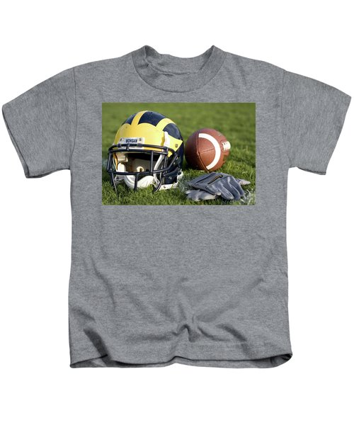 Helmet On The Field With Football And Gloves Kids T-Shirt