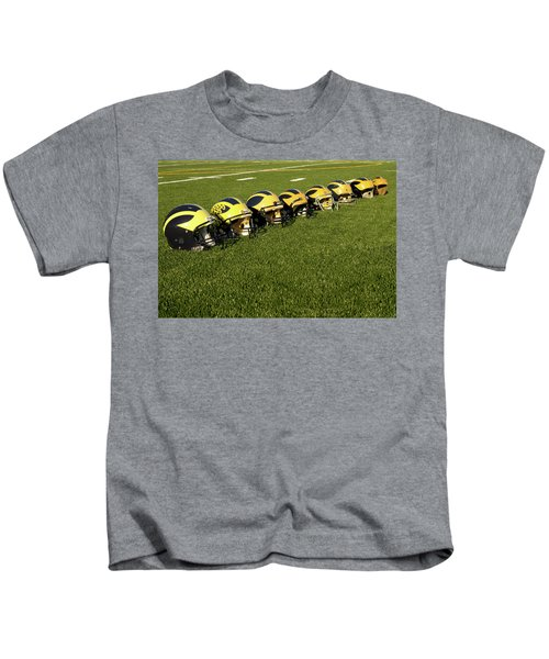 Helmets Of Different Eras On The Field Kids T-Shirt