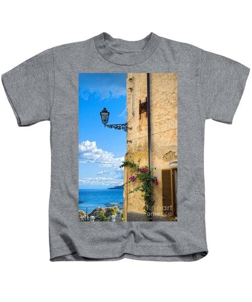 House With Bougainvillea Street Lamp And Distant Sea Kids T-Shirt