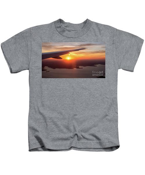 Looking At Sunset From Airplane Window With Lake In The Backgrou Kids T-Shirt