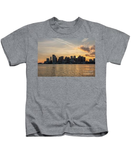 Seagull Flying At Sunset With The Skyline Of Boston On The Backg Kids T-Shirt