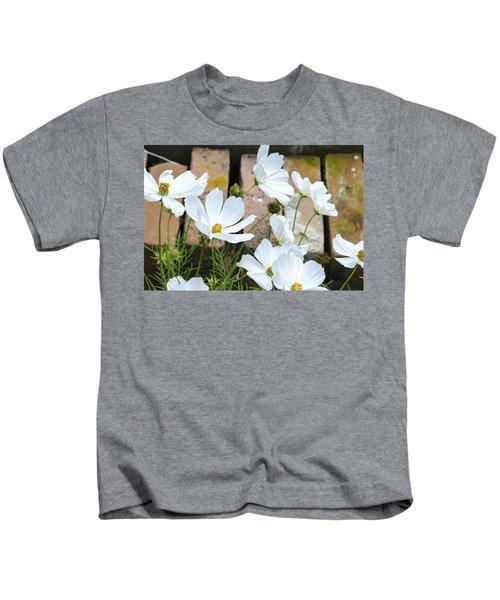 White Flowers Against Bricks Kids T-Shirt