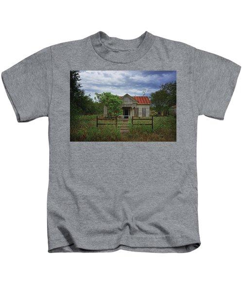 Texas Farmhouse In Storm Clouds Kids T-Shirt