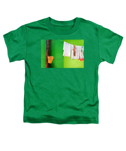 Toddler T-Shirt featuring the photograph Vase Towels And Green Wall by Silvia Ganora