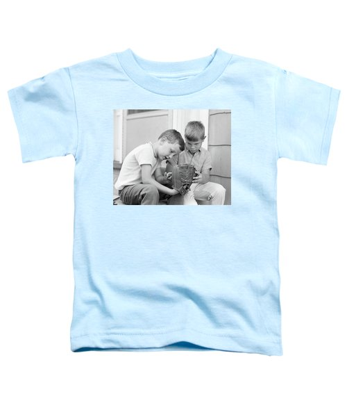 1970s Two Boys Seriously Inspecting New Toddler T-Shirt