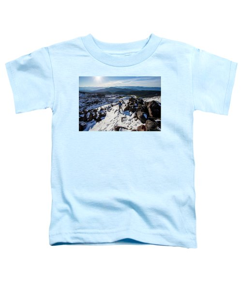 A Climber Moves Uphill Through The Snow Toddler T-Shirt