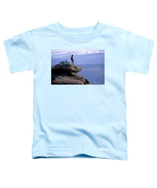 A Female Mountain Biker Stands Toddler T-Shirt