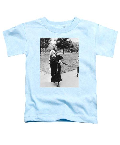 Nun Swinging A Baseball Bat Toddler T-Shirt