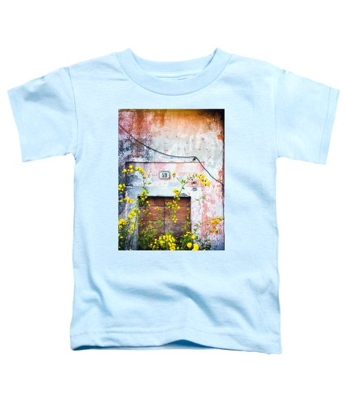 Toddler T-Shirt featuring the photograph Yellow Flowers And Decayed Wall by Silvia Ganora