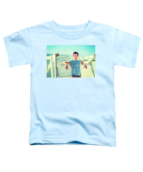 Young Man Relaxing On The Beach Toddler T-Shirt