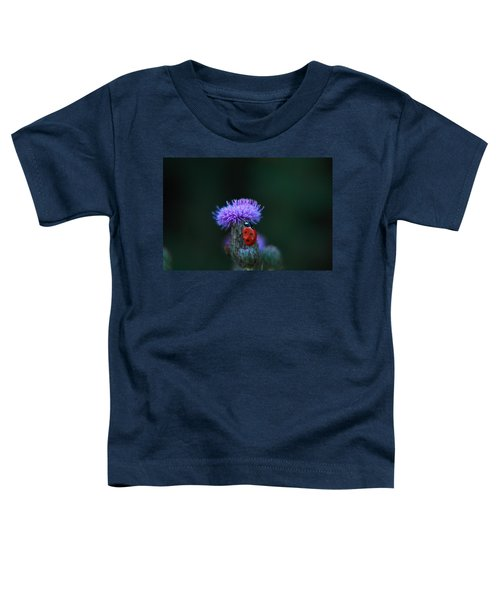 A Lady Bug Climbing A Thistle Toddler T-Shirt