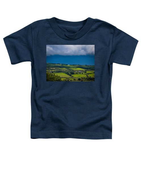 Toddler T-Shirt featuring the photograph Clouds Over Shimmering Green Irish Countryside by James Truett