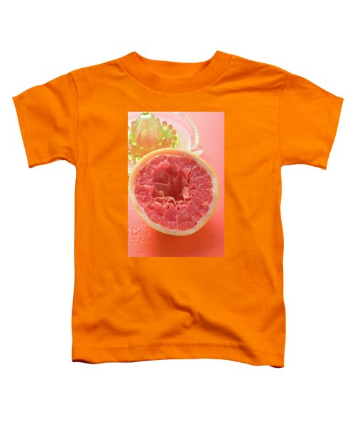 Squeezed Pink Grapefruit In Front Of Citrus Squeezer Toddler T-Shirt