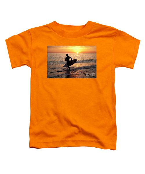 A Young Man Surfing At Sunset Off Aberystwyth Beach, Wales Uk Toddler T-Shirt