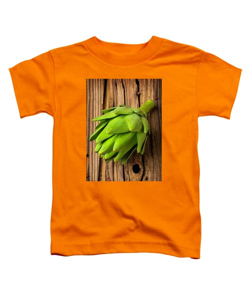 Artichoke On Old Wooden Board Toddler T-Shirt by Garry Gay