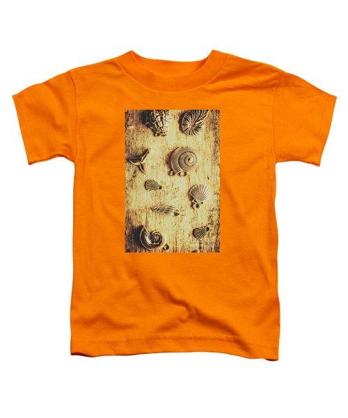 Seashell Shaped Pendants On Wooden Background Toddler T-Shirt