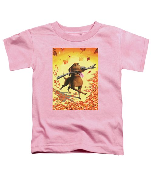 A Dog Carries A Stick Through Fall Leaves Toddler T-Shirt