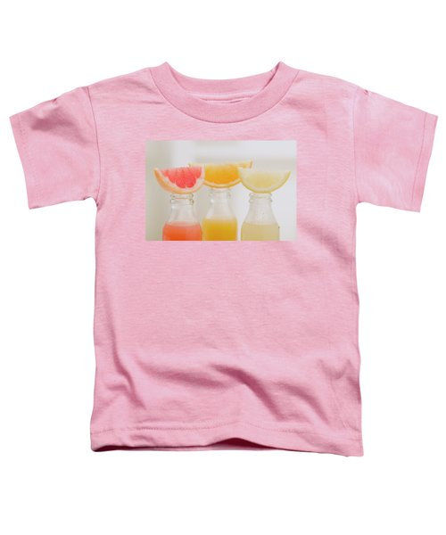 Three Fruit Juices In Bottles With Wedges Of Fresh Fruit Toddler T-Shirt
