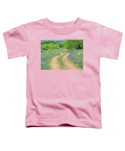 A Dirt Road Lined By Blue Bonnets Of Texas Toddler T-Shirt