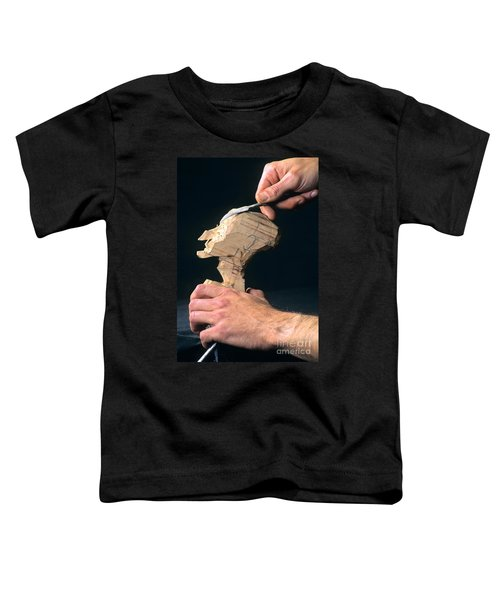 Puppet Being Carved From Wood Toddler T-Shirt