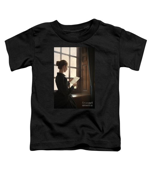 Victorian Or Edwardian Woman Reading A Letter By The Window Toddler T-Shirt