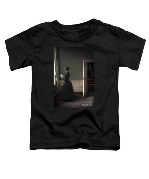 Woman In A Black Victorian Mourning Dress Reads A Letter By The  Toddler T-Shirt