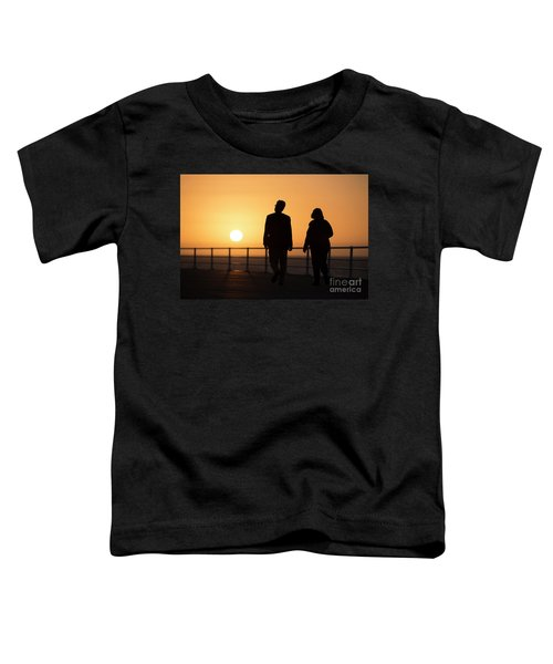 A Couple In Silhouette Walking Into The Sunset Toddler T-Shirt