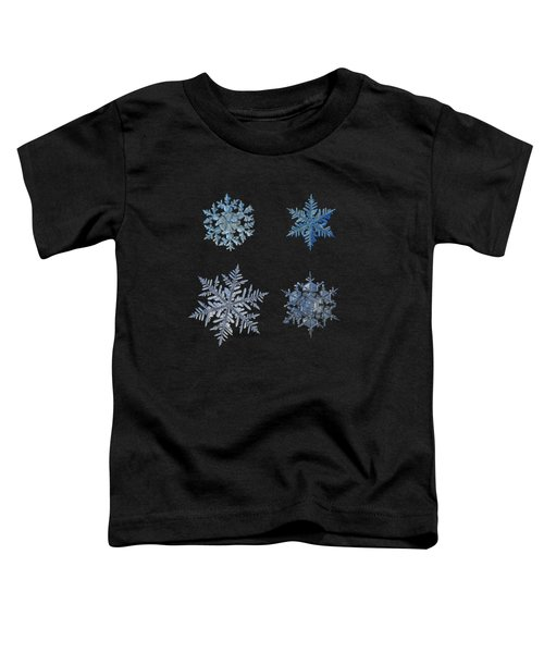 Four Snowflakes On Black Background Toddler T-Shirt