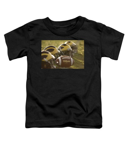 Helmets And A Football On The Field At Dawn Toddler T-Shirt