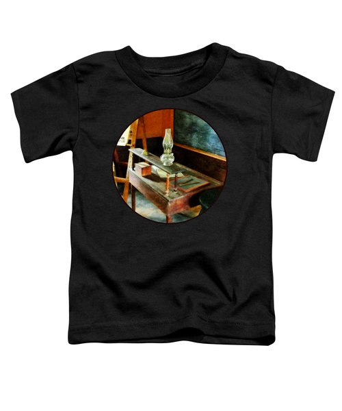 Teacher's Desk With Hurricane Lamp Toddler T-Shirt