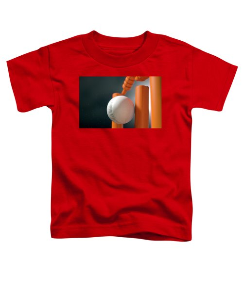 Cricket Ball Hitting Wickets Toddler T-Shirt by Allan Swart
