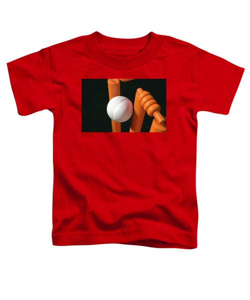 Cricket Ball Hitting Wickets Toddler T-Shirt by Allan Swart