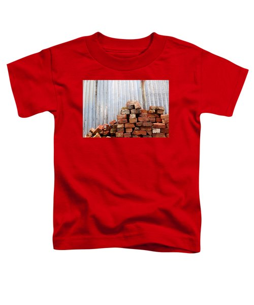 Toddler T-Shirt featuring the photograph Brick Piled by Stephen Mitchell
