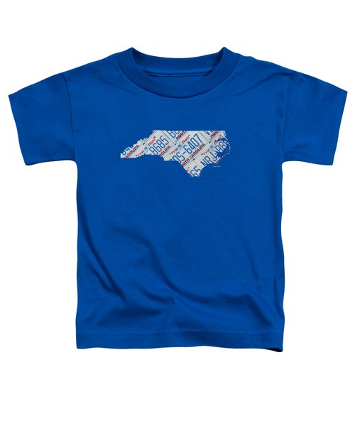 North Carolina Vintage Recycled License Plate Map On Blue Wood Plank Background Toddler T-Shirt