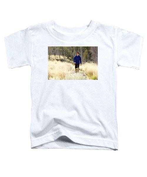 A Man In A Blue Jacket Walks Toddler T-Shirt