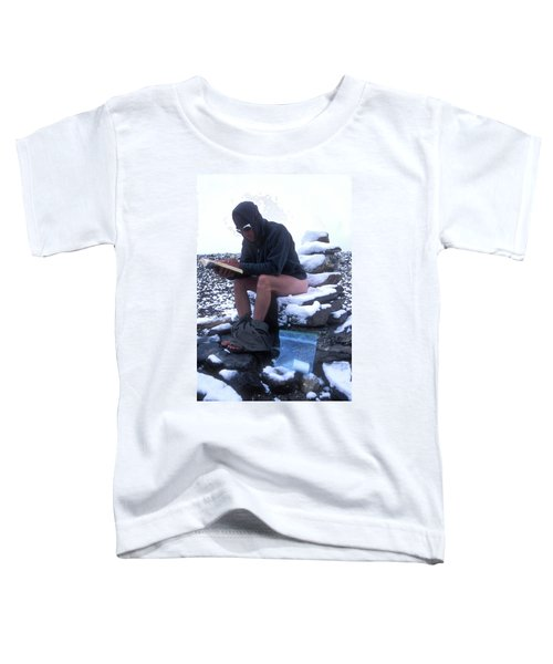 A Man Reads While Using A Snow-covered Toddler T-Shirt