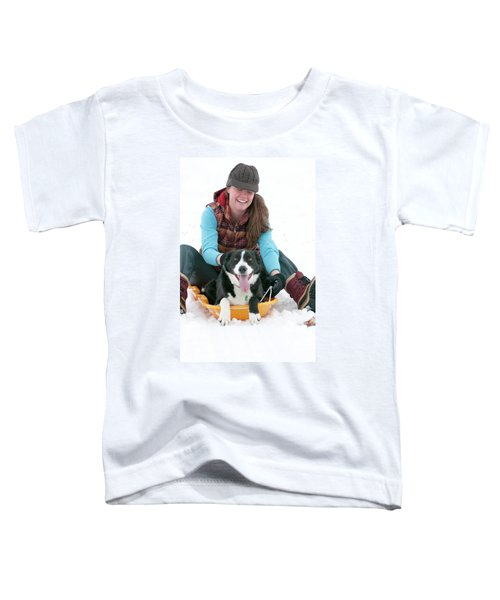 A Smiling Young Woman Rides A Sled Toddler T-Shirt