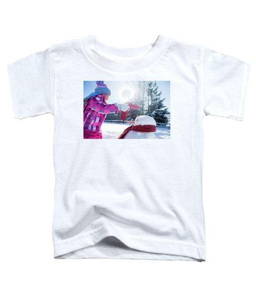 A Young Girl Building A Snowman Toddler T-Shirt