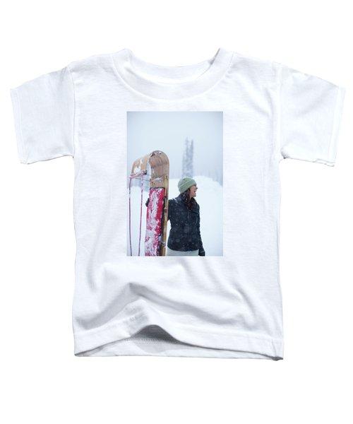 Woman Standing With Toboggan Sled Toddler T-Shirt