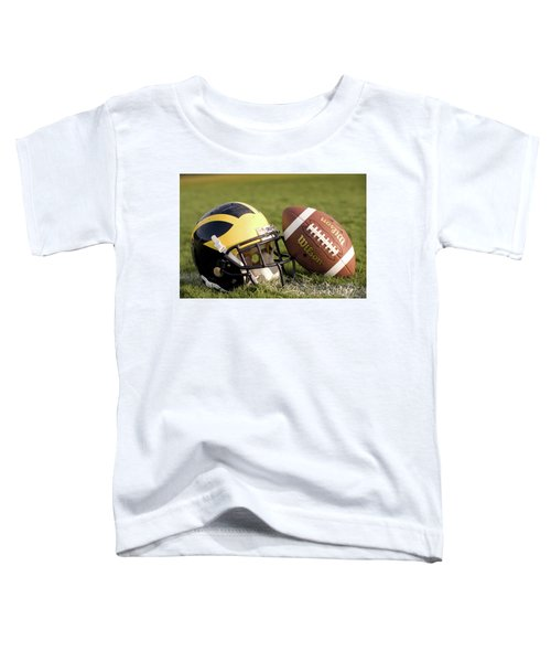 Wolverine Helmet With Football On The Field Toddler T-Shirt