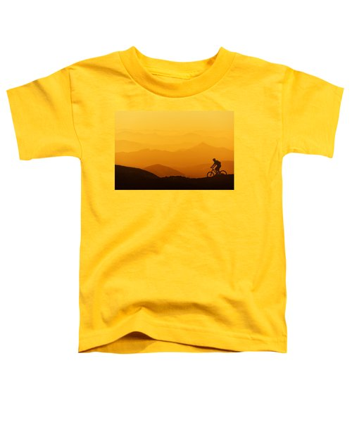 Biker Riding On Mountain Silhouettes Background Toddler T-Shirt