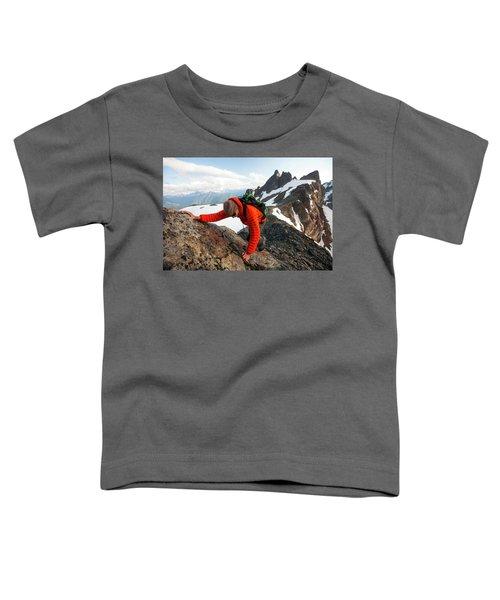A Climber Scrambles Up A Rocky Mountain Toddler T-Shirt
